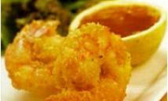 Cam,arão empanado no coco com molho de laranja