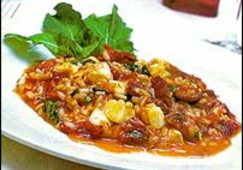 Risoto de tomate seco, rúcula e mussarela