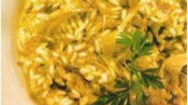 Risoto de galinha de angola